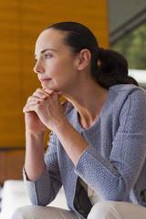 Thinking woman in grey cardigan