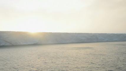 Sunrise on a glacier reaching the sea