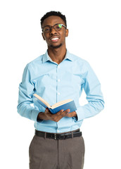 Happy african american college student with books in his hands