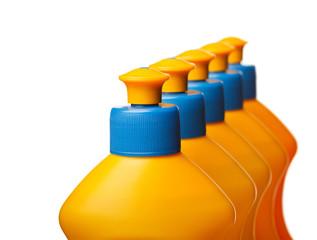 Top of yellow plastic bottles