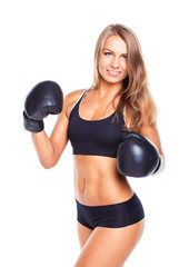 Young athletic woman in boxing gloves on a white
