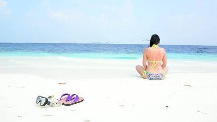 Woman is relaxing at tropical beach
