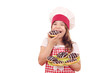hungry little girl cook eating chocolate donuts