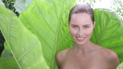 Woman in giant leaves