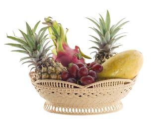 Basket of fresh fruits isolated on white