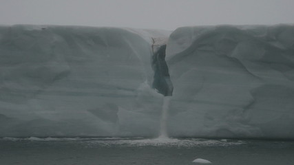 Waterfall in a glacier reaching the sea 2