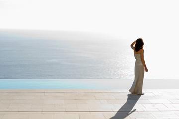 Woman alone facing the sea