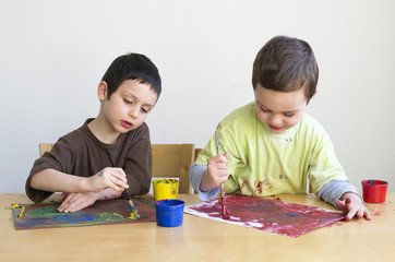 Children painting with colors