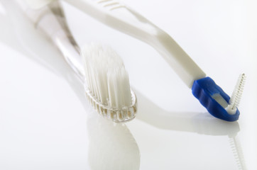 toothbrush and ruff on white table