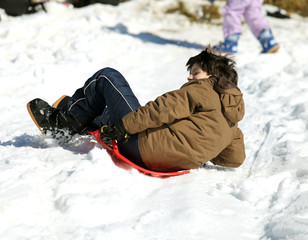 Guy plays with sledding on snow