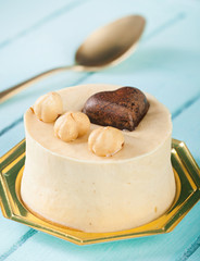 Small cake with hazelnuts and chocolate heart.