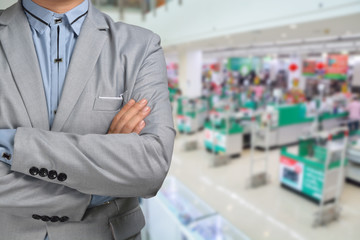 Business Man stand in Hypermarket or Supermarket store present r