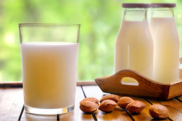 Glass of almond milk on a front table view