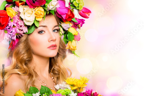 Spring woman. Beauty portrait with flowers hairstyle
