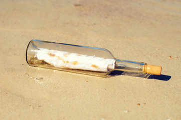 Bottle with message on the beach.