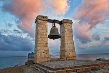 Alarm ancient bell on bank of Black Sea, Chersonese