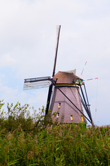 Windmill in Kinderdijk in cloudy day, Netherlands