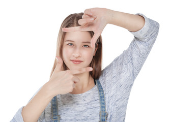 Young fashion girl looking through hands frame isolated