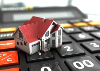 Real estate concept house on calculator