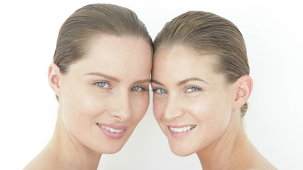 Two women forehead to forehead