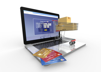 Shopping cart and credit cards on laptop