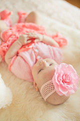 Little baby girl wearing pink knitting dres