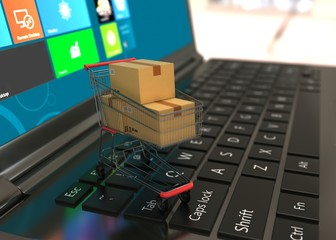E-commerce Shopping cart  with cardboard boxes on laptop