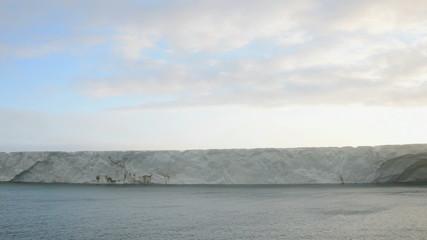 Sunrise on a glacier reaching the sea 2