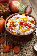 Sweet pilaf with pumpkin, apples and dried fruit