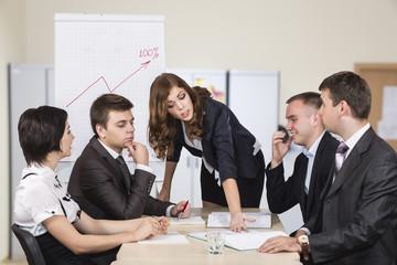 Severe female manager criticises her team of subordinates