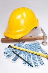 builder's tools - helmet, work gloves, hammer, pen and measure t
