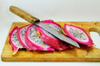 dragon fruit and knife on chopping block
