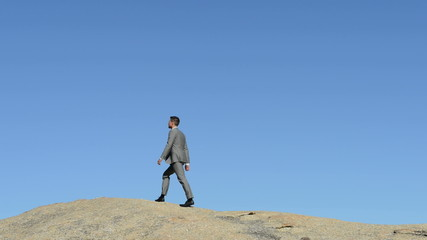 Businessman on to of hill