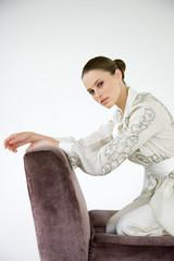 Woman on an armchair