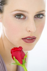 Woman's face and rose