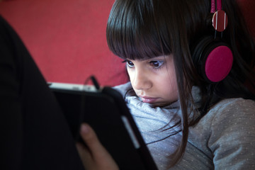 Little girl using tablet pc