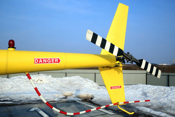 tail of a yellow helicopter