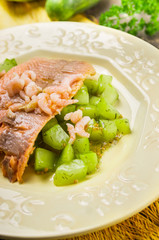 Trout with braised cucumber and shrimp , clouse up