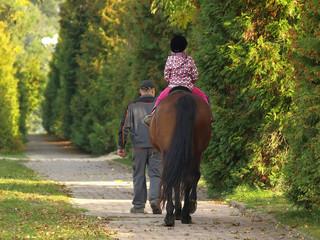 little girl on a horse