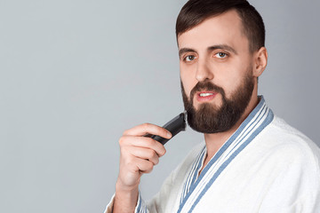 Bearded man with a razor