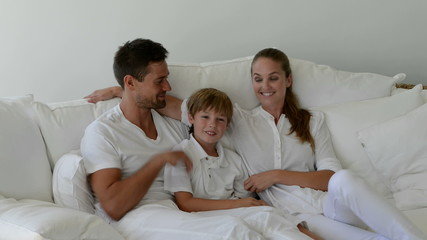 Happy family on a sofa