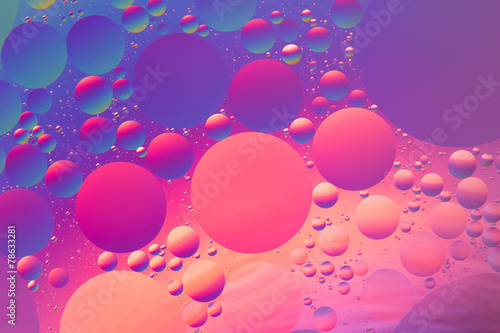 Psychedelic oil and water abstract in purple,  red and blue - 78633281