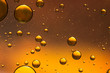 Oil and water abstract in gold and brown - 78633440