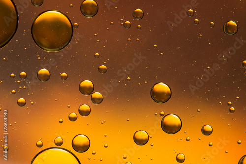 Oil and water abstract in gold and brown