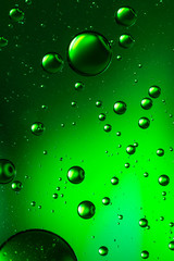 Oil and water abstract in vivid green