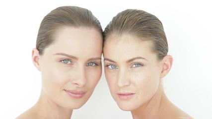 Two women cheek to cheek