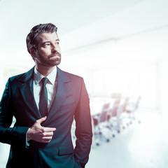 Businessman in brigt office room