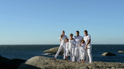 Multi generation family on beach rocks