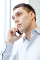 serious businessman with smartphone