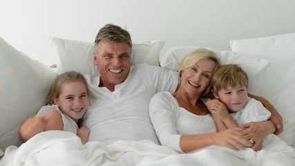 Grandparents and grandchildren in bed